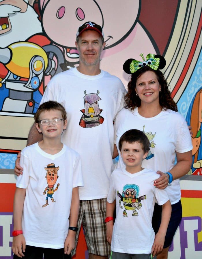 Wearing our Disney family shirts at Toy Story Land at Disney World